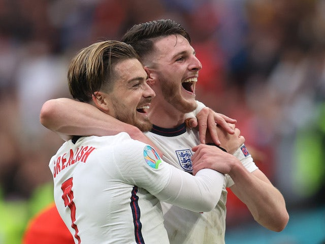 Jack Grealish and Declan Rice celebrate as England beat Germany on June 29, 2021