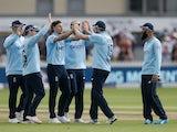 England's Chris Woakes celebrates with teammates against Sri Lanka on July 4, 2021
