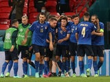 Italy's Federico Chiesa celebrates scoring their first goal with teammates on June 26, 2021
