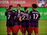 New England Revolution forward Gustavo Bou celebrates scoring with teammates on June 28, 2021