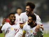 Qatar's Hassan Al Haydos celebrates scoring their first goal with teammates on June 7, 2021