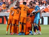 Houston Dynamo FC starting players huddle before the start of the match on June 24, 2021