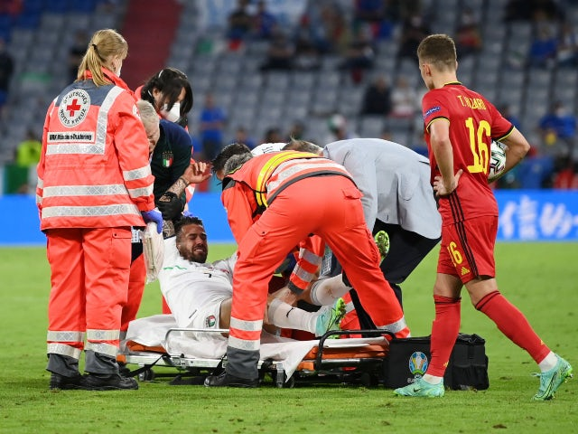 Italy's Leonardo Spinazzola goes down injured against Belgium at Euro 2020 on July 2, 2021