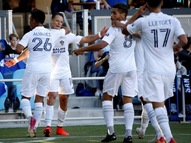 Los Angeles Galaxy forward Javier Hernandez celebrates with teammates after scoring a goal on June 27, 2021