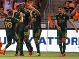 Portland Timbers forward Jeremy Ebobisse celebrates with teammates after scoring a goal during stoppage time on June 24, 2021