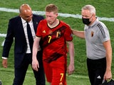 Belgium's Kevin De Bruyne with Belgium coach Roberto Martinez after being substituted after sustaining an injury on June 27, 2021