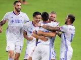FC Cincinnati midfielder Luciano Acosta celebrates with teammates scoring a goal on June 27, 2021