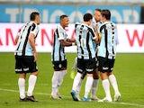 Gremio's Matheus Henrique celebrates scoring their first goal with teammates on June 25, 2021