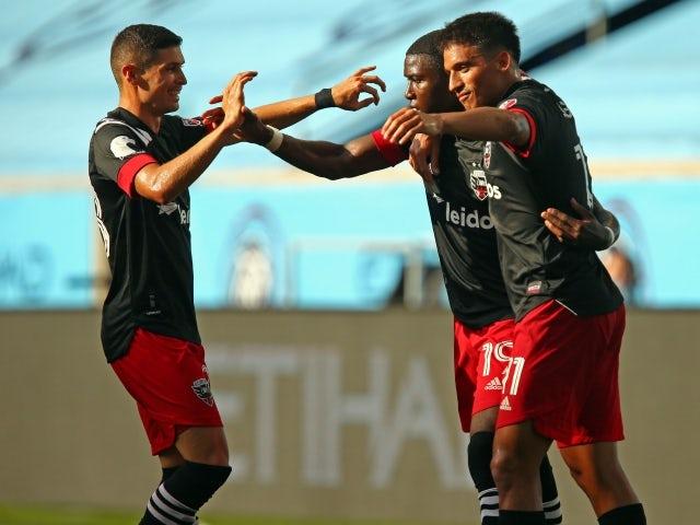 DC United forward Nigel Robertha celebrates scoring with teammates on June 27, 2021