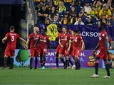 Toronto FC players celebrate after a goal by forward Patrick Mullins on June 24, 2021