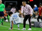 Inter Miami head coach Phil Neville helps D.C. United midfielder Kevin Paredes (30) to get up on June 9, 2021