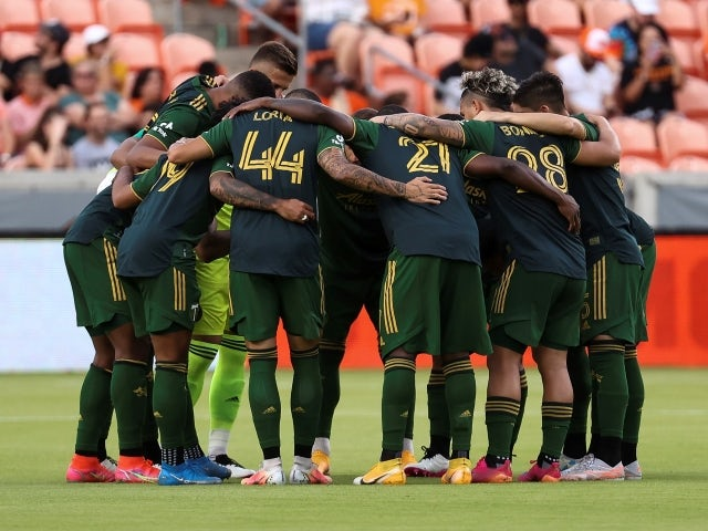 Portland Timbers starting players huddle before the start of the match on June 24, 2021