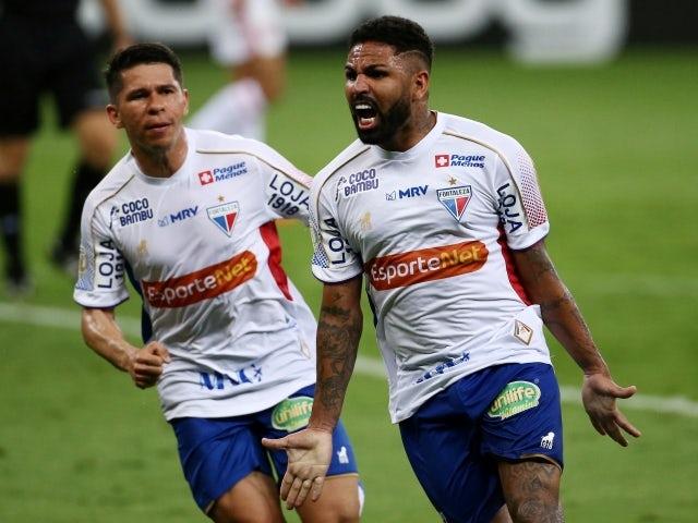 Fortaleza's Romarinho celebrates scoring their second goal with teammates on January 18, 2021
