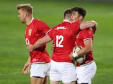 The Lions celebrate Louis-Rees Zammit's try against the Sigma Lions on July 3, 2021