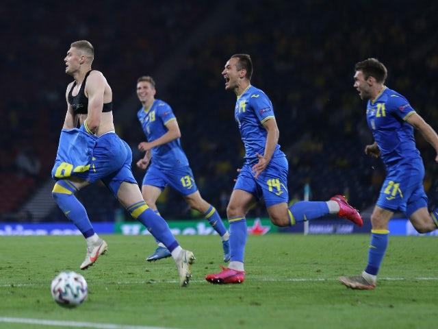 Ukraine's Artem Dovbyk celebrates scoring their second goal against Sweden at Euro 2020 on June 29, 2021