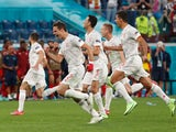 Spain celebrate beating Switzerland on penalties at Euro 2020 on July 2, 2021