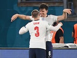 England duo Harry Maguire and Luke Shaw celebrate against Ukraine at Euro 2020 on July 3, 2021
