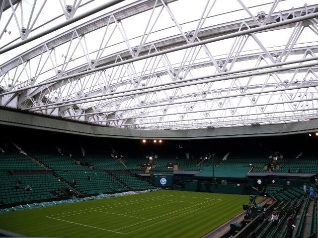 Wimbledon matches cancelled as rain disrupts day one