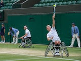 Britain's Alfie Hewett and Gordon Reid in action during the men's wheelchair doubles final at Wimbledon on July 10, 2021