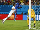 Italy's Mario Balotelli scores against England at the 2014 World Cup on 15 June, 2014