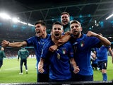 Italy celebrate beating Spain on penalties at Euro 2020 on July 6, 2021