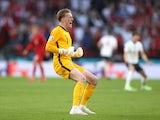 Jordan Pickford celebrates England's equaliser against Denmark on July 7, 2021