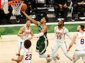Milwaukee Bucks forward Giannis Antetokounmpo shoots a layup during the second quarter against the Phoenix Suns on July 12, 2021