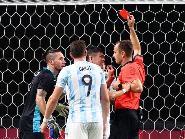 Francisco Ortega of Argentina is shown a red card by referee Leodan Gonzalez on July 22, 2021