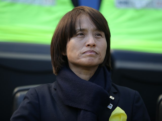Japan head coach Asako Takakura stands for introductions before a game against England in the 2020 She Believes Cup soccer series at Red Bull Arena in May 2020