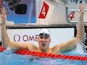 Chase Kalisz celebrates winning gold on July 25, 2021