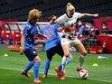 Honoka Hayashi of Japan and Yuzuho Shiokoshi of Japan in action with Sophie Ingle of Britain at the Tokyo Olympics on July 24, 2021