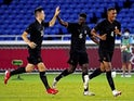 Germany forward Ragnar Ache (6) celebrates his goal with teammates during the second half against Brazil in Group D play during the Tokyo 2020 Olympic Summer Games at Nissan Stadium on July 22, 2021