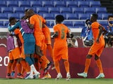 Franck Kessie of Ivory Coast celebrates scoring their second goal with teammates on July 22, 2021