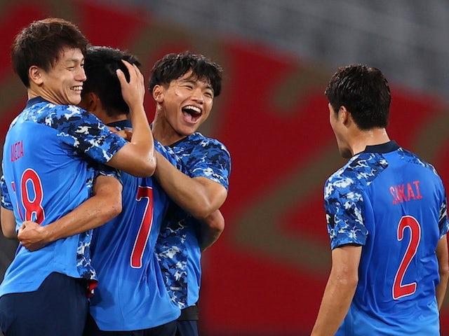 Takefusa Kubo of Japan celebrates scoring their first goal with teammates on July 22, 2021