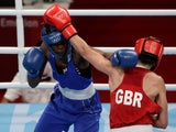 Keamogetse Kenosi of Botswana in action against Karriss Artingstall of Britain at the Tokyo Olympics on July 24, 2021