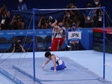 Kohei Uchimura pictured after falling during his high bar routine at the Tokyo Olympics on July 24, 2021