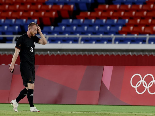 Maximilian Arnold of Germany walks off the pitch after being shown a red card by referee Ivan Barton on July 22, 2021