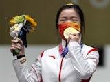 Gold medallist Yang Qian of China celebrates on the podium on July 24, 2021