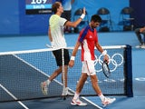 Alexander Zverev of Germany with Novak Djokovic of Serbia after winning his semifinal match at the Tokyo 2020 Olympics on July 30, 2021