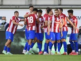 Atletico Madrid's Ricard Sanchez celebrates scoring their second goal with teammates on July 31, 2021
