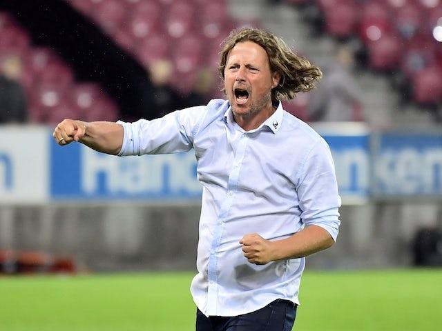 Треньорът на C Midtjylland Бо Хенриксен ще празнува след мача на 28 юли 2021 г.