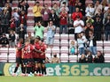 Bournemouth's Dominic Solanke celebrates scoring their second goal against MK Dons in the EFL Cup on July 31, 2021