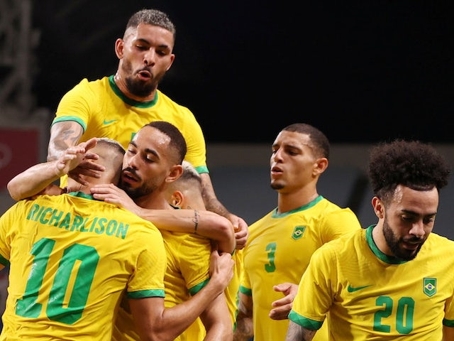 Matheus Cunha of Brazil celebrates scoring their first goal with teammates on July 31, 2021