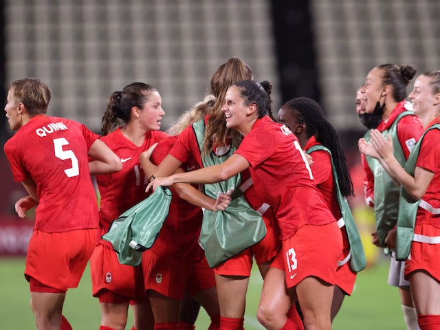 Adriana Leon of Canada celebrates after scoring their first goal with teammates on July 27, 2021