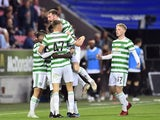 Celtic's Callum McGregor celebrates scoring their first goal with teammates  on July 28, 2021