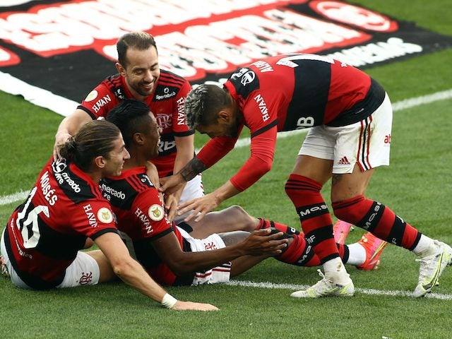 Flamengo's Bruno Henrique celebrates scoring their third goal with Filipe Luis and teammates on August 1, 2021