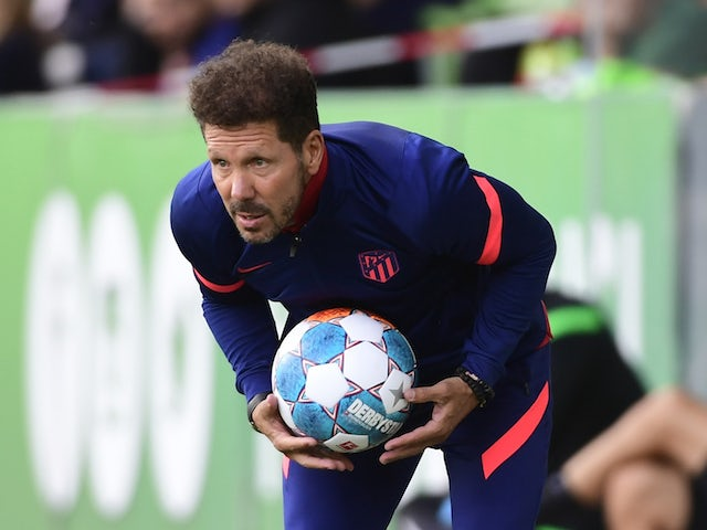 Atletico Madrid coach Diego Simeone holding the ball during the match on July 31, 2021