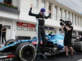 Esteban Ocon celebrates winning the Hungarian Grand Prix on August 1, 2021