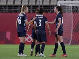 Caroline Weir of Britain celebrates after scoring their first goal with teammates against Canada at the Tokyo 2020 Olympics on July 27, 2021