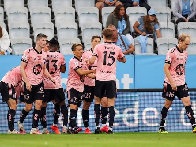 HJK Helsinki's Roope Riski celebrates scoring their first goal with teammates on July 21, 2021